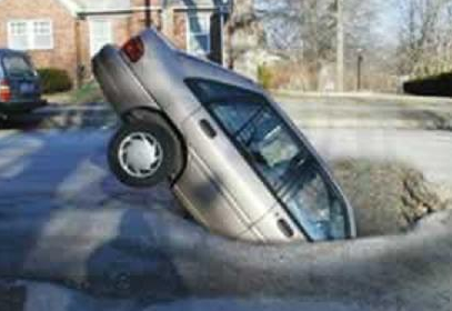 Car in pot hole